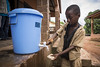 Sekouba, 10, washes his hands with soap before entering his classroom as a preventative measure to stop the spread of Ebola at Ecole Primaire Forécariah Centre, Guinea. In this school, hand-washing facilities have been supplied by UNICEF with the support of the EU.  Photo credit: EU/ECHO/Jonathan Hyams