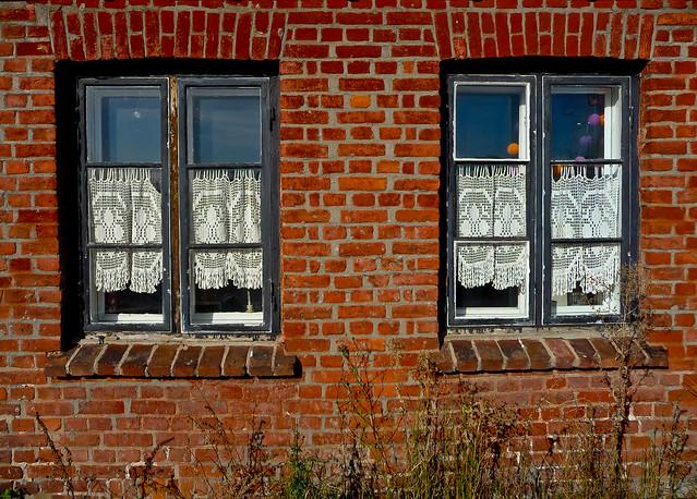 Brick wall, crochet curtains