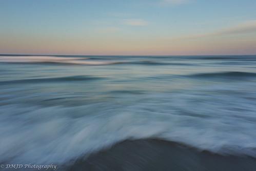 ocean sunset coast surf waves shoreline maryland shore coastline assateague altantic