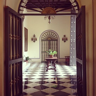 Great Spanish architecture and art fill the hallways of Hotel El Convento. #hotelelconvento #hotel #spanish #architecture #door #doorway #oldsanjuan #tile | by brianwiese