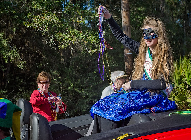Sweet Miss Dauphin Island throws beads in the People's Parade during Mardi Gras in Dauphin Island, Alabama
