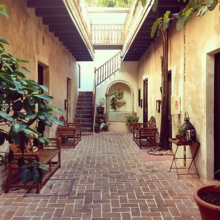 Charming open patio hallways in Old San Juan, Puerto Rico at Villa Herencia. #sanjuan #villaherencia #puertorico #hotel #patio #architecture #spanish | by brianwiese