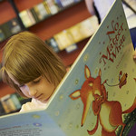 Enjoying a book in the Baillie Gifford Children's Bookshop | Little girl enjoys one of Debi Gliori's books in the Children's Bookshop © Helen Jones