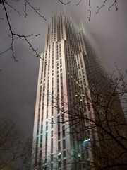 NYC building rising into the fog