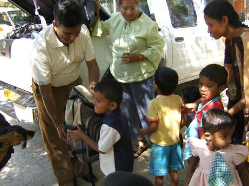Channa Ranasinge Distributing Backpacks