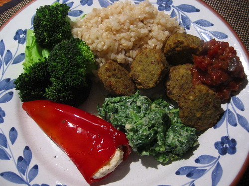 Brown rice, falafel, yoghurt and spinach, broccoli, stuffed red pepper