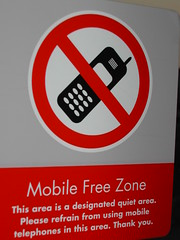 Mobile Free Zone. This area is a designated quiet area. Please refrain from using mobile telephones in this area. Thank you.