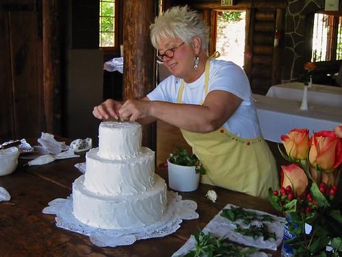 Mimi decorating the cake