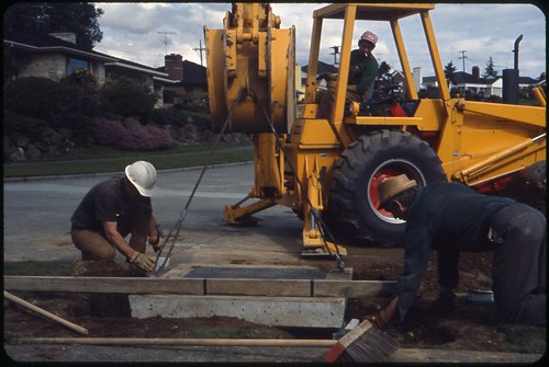 Workers installing underground electricity distribution lines, circa 1980 | by Seattle Municipal Archives