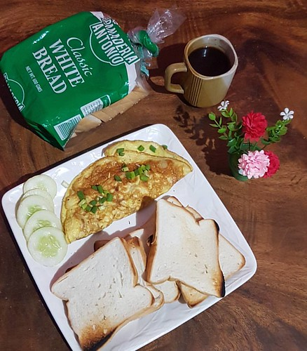 Breads from Panaderia Antonio, Scrambled Egg and coffee are simple yet palatable for the lazy afternoon to be awake. | by Jinkee Umali