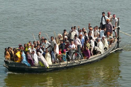 people india ferry river boat crowd ganga bicyle ganges bihar buxar earthasia