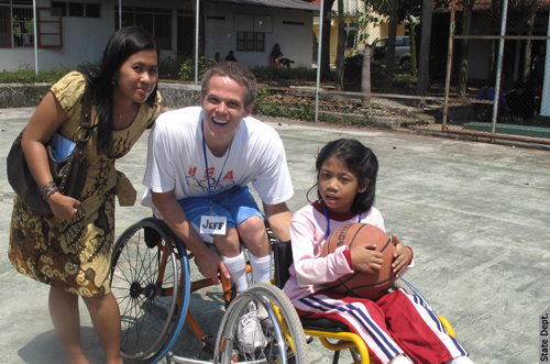 Coach Jeff playing basketball with a student. | by U.S. Embassy Jakarta, Indonesia
