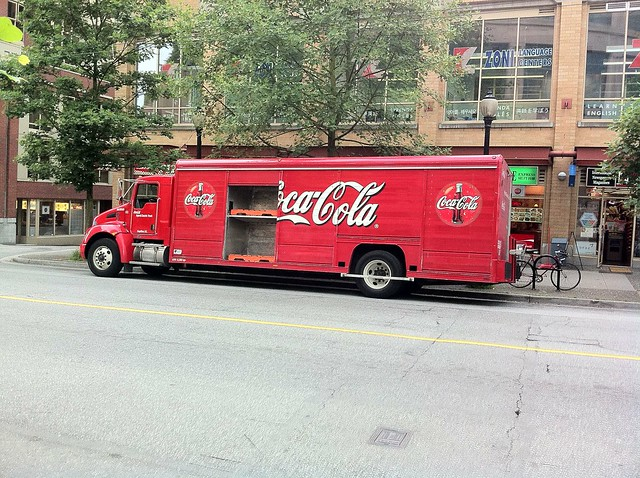Hybrid Coca-Cola delivery truck with compartment open