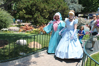 Cinderella and the Fairy Godmother stroll hand-in-hand near Pixie Hollow | by Castles, Capes & Clones