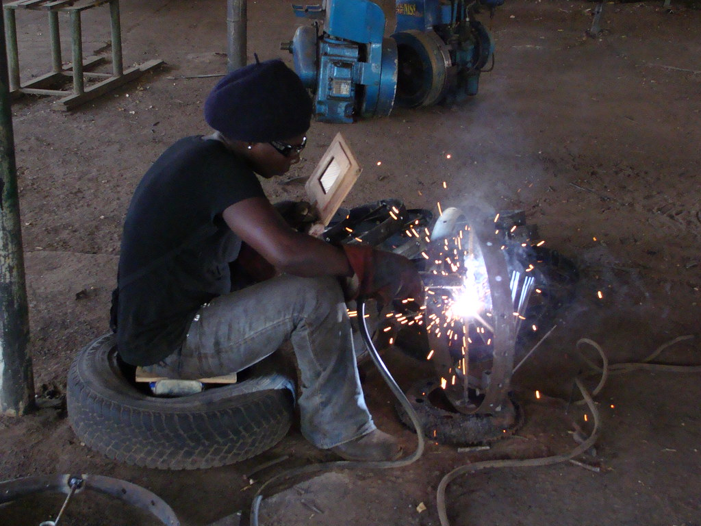 Welder in Ghana | A welder at Tamale Instruments works on a