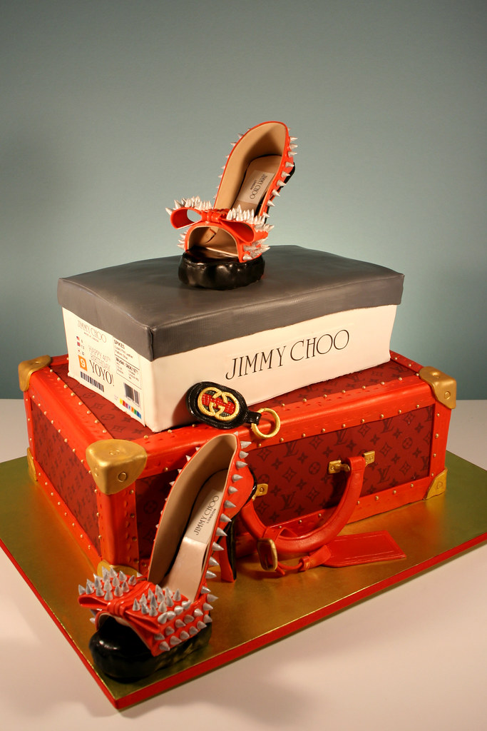 0927bf98780 ... Jimmy Choo Spiked Red Soled heels and Red Louis Vuitton Case