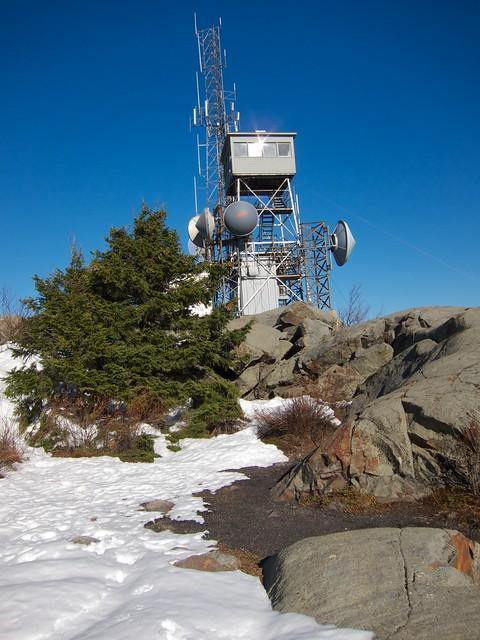 0:57:04 (49%): tower hiking newhampshire lensflare mtkearsarge