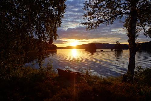 sunset summer lake water landscape evening boat sweden hills serene waterscape