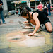 G. chalk-painting downtown as part of a public art project.  She is in front of Westlake Center each Friday this summer! Go see her awesome work, or hit her website up: <a href=
