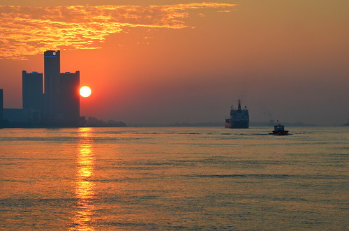 red orange sun clouds sunrise amber gm detroit headquarters center renaissance freighter