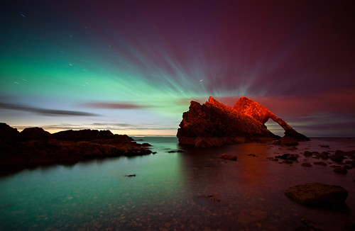 Northern Lights behind Bow Fiddle Rock, Moray, Scotland | by Kenny Muir
