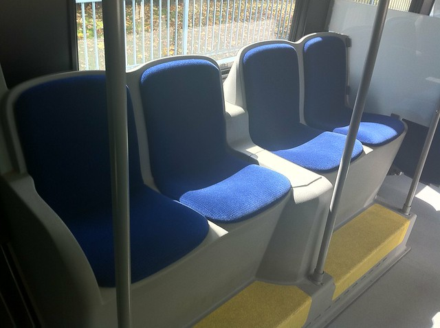 Four side-facing seats in the middle of a Nova Bus LFX