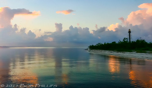 lighthouse clouds sunrise reflections sanibel topazdenoise5