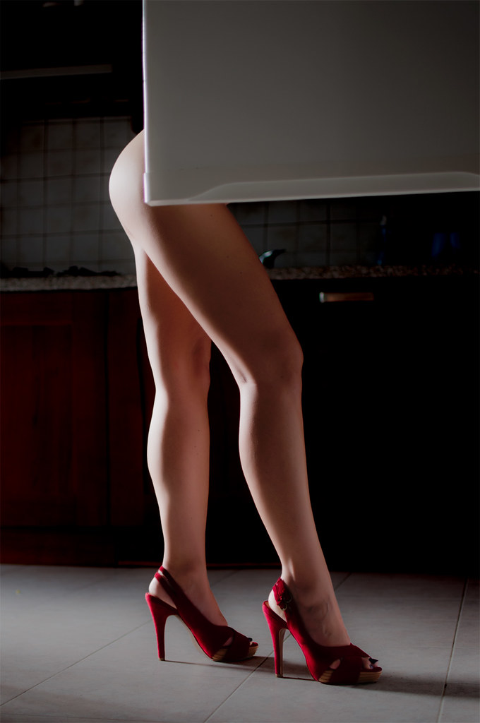 Sexy Woman Legs On High Heels Resting On White Stock Photo By Prostock