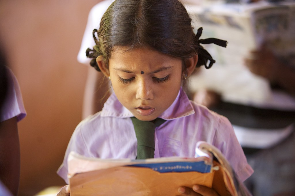 A school girl concentrating on reading an English song in …   Flickr