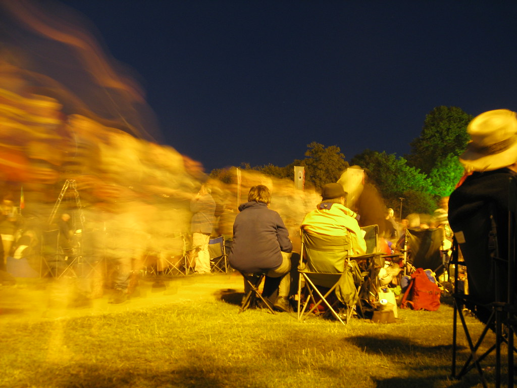 People stream by - People moving to and from the main stage … - Flickr