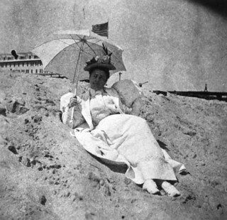 Lady in white reclining on the beach: Palm Beach, Florida | by State Library and Archives of Florida