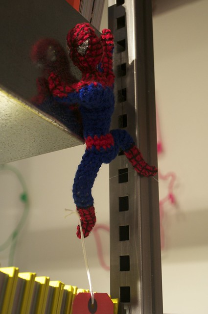 Spiderman clinging on