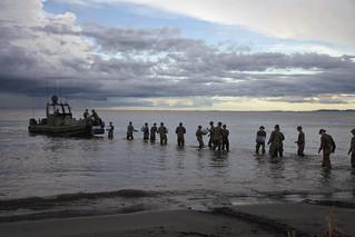 Marines assigned to the 2nd Assault Amphibian Battalion, Ground Combat Element, unload supplies