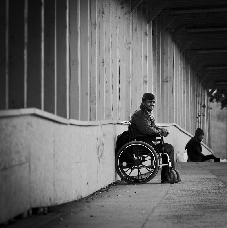 beggar in wheelchair