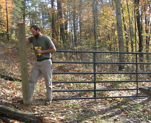 Matt installing a new farm gate at the existing entrance.