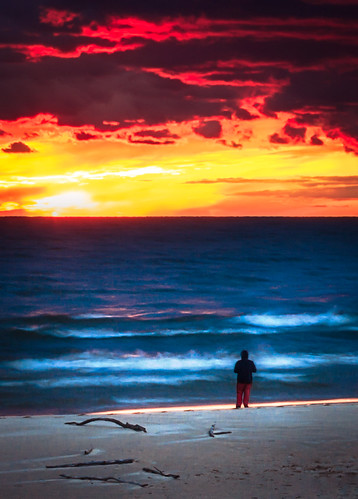 light sunset red sky cloud cold beach water hope colorful solitude alone horizon extreme atmosphere windy lakemichigan burning lakeshore solitary contemplative fiery distant