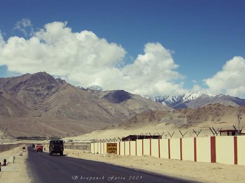 roads mountains city lofty sky cloudscape