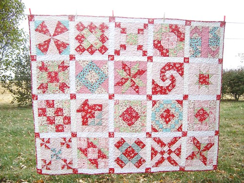 Red and white (mostly) sampler quilt on a gloomy day