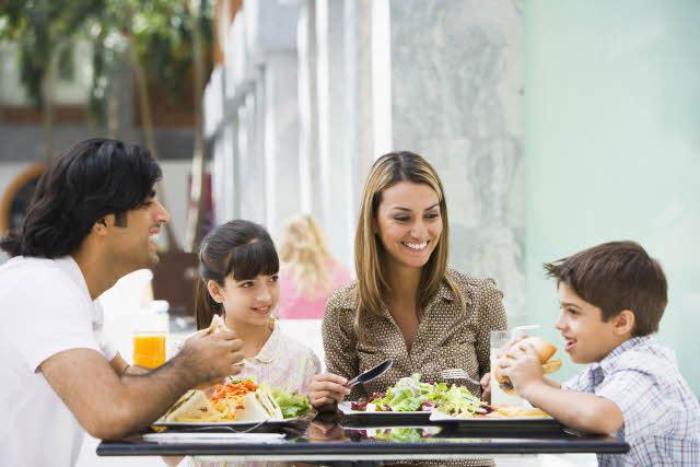 Family having lunch at restaurant