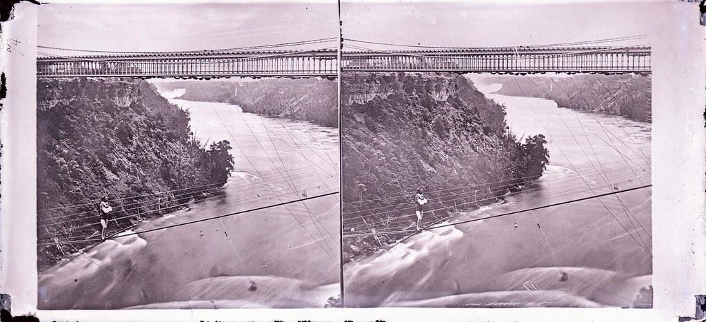 Man walking on tightrope over Niagara Falls]   Creator: Gir