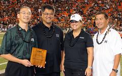 University of Hawaii Alumni Association's Douglas Inouye, far left, and Alvin Katahara, far right, presented the award to Chevron Hawai'i's Albert Chee, Jr., middle left, and Carina Tagupa.