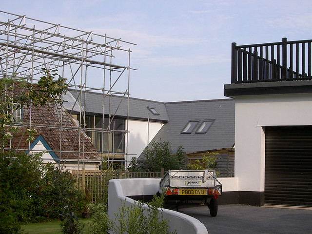 <p>Demolish garage and build new garage with bedroom above. Take down existing first floor and rebuild first floor and roof. Extensive alterations have transformed this 1930s bungalow into a contemporary house.</p>