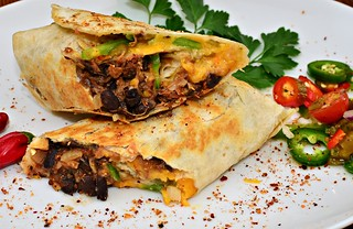Mmm... Black bean burrito with pork and cheddar | by jeffreyw