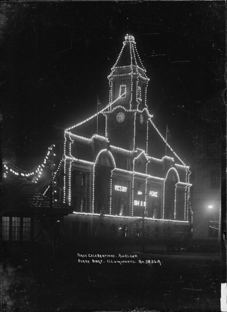 View of Auckland Ferry Building taken at night to show the Peace celebration illuminations - Alexander Turnbull Library