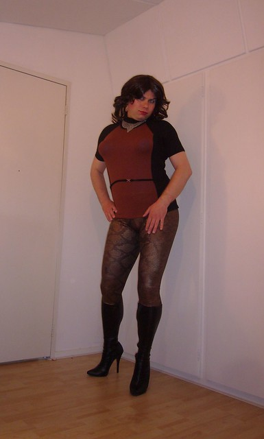 tight top, snake leggings, and stiletto boots