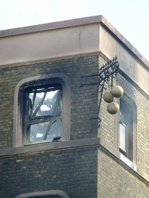 London road flats above Jewellers and brass monkey symbol