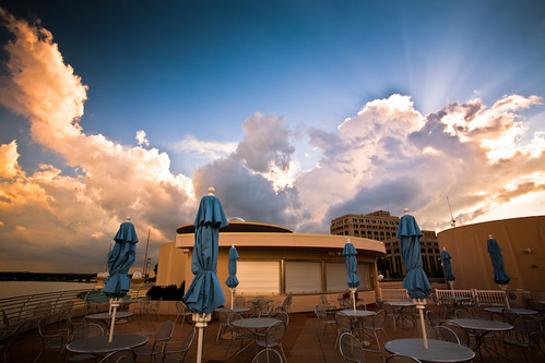 city blue light sunset summer sky urban usa storm rooftop weather june wisconsin architecture publicspace clouds photography restaurant evening photo cafe midwest closed downtown chairs image dusk empty picture stormy franklloydwright patio madison cumulus tables northamerica rays sunrays umbrellas canonef1740mmf4lusm cloudscape sunbeams stormclouds afterhours mononaterrace lakemonona isthmus 2011 canoneos5d danecounty madison365 portalwisconsinorgselected lorenzemlicka lakevistacafe williamtevjuerooftopgarden portalwisconsinorg062911
