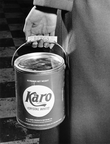 A person carrying a can of Karo syrup at Berg's Supermarket, circa 1950 | by OSU Special Collections & Archives : Commons