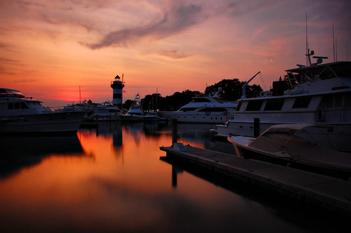 sunset night clouds reflections boats landscapes iso200 nikon dusk southcarolina silhouettes sunsets sunsetglow sailboats harbors beautifulclouds pinoy 30secondexposure marinas longexposures hiltonheadisland travelphotography harbourtown beautifulskies d40 wetreflections sunsetreflections sunsetskies caliboguesound wbauto vacationshots harbourtownlighthouse sunsetshots goldensunsets perfectsunsetssunrisesandskys sunsetimages manualmodeexposure harbourtownmarina setholiver1 bwnd10stopfilter aperturef220 18105mmnikkorlens timedelaytriggeredshot ballheadtripodmuntedshot daytimelightexposures pwpartlycloudy