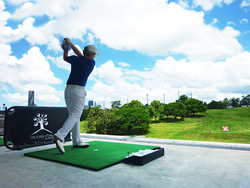 Golf professional driving on range | by Brisbane City Council